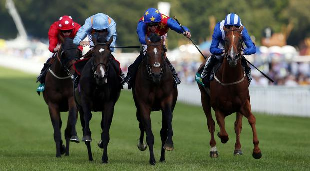 Es Que Love (centre) ridden by Adam Kirby wins the Lennox Stakes during day one of Glorious Goodwood. Photo: Steve Parsons/PA Wire