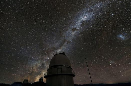 Scientists have discovered that the real Milky Way, the galaxy containing the Sun and its family of planets, is lighter than was previously thought. PA