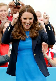 Catherine, Duchess of Cambridge celebrates as she plays South African games 'Three Tins' during a visit to the Commonwealth Games Village at the 2014 Commonwealth Games in Glasgow. Reuters