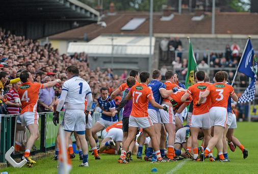 Armagh and Cavan players involved in a disagreement before their match in June.