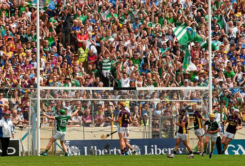 Shane Dowling (left) celebrates scoring Limerick's second goal against Wexford in front of the Treaty fans at Semple Stadium. Photo: Ray McManus / SPORTSFILE