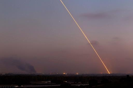 Light streak trail is seen as a rocket is launched from the northern Gaza Strip towards Israel. Reuters