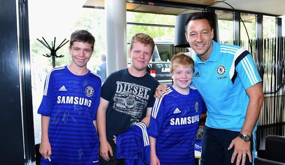 Oran Tully with his brothers meeting John Terry