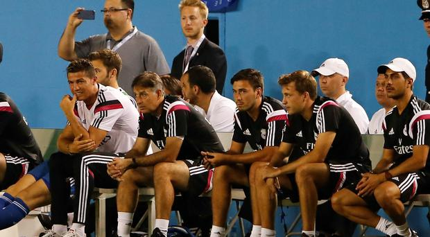 Cristiano Ronaldo (7) sits at the end of the bench during the second half against the AS Roma at Cotton Bowl Stadium