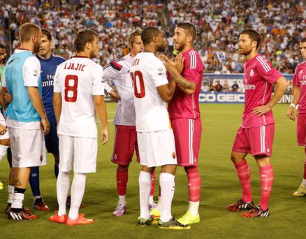 Real Madrid defender Sergio Ramos (4) argues with Roma midfielder Seydou Keita (20) after the incident
