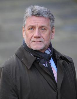 Neil Wallis who is one of two former News of the World journalists who have been charged with conspiring to hack phones, prosecutors have announced