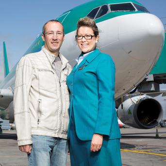 Patrick Loureiro with Aer Lingus Cabin Crew Member Audrey Lorigan pictured at Dublin airport on the occasion of the reunion with Patrick Loureiro and the cabin crew of the flight on 11 June 1975 on which Patrick was born. Photo: Anthony Woods
