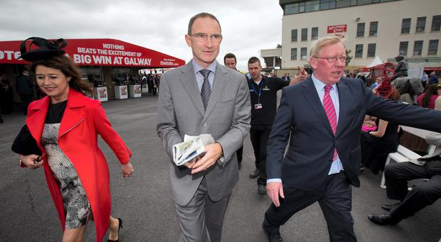 Republic of Ireland manager Martin O'Neill and his wife Geraldine at the Galway Races with race course manager John Moloney. Photo: Mark Condren