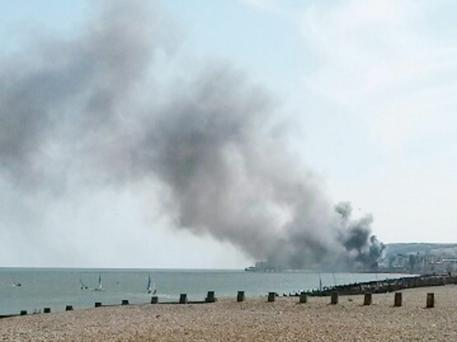 Eastbourne Pier where a fire has broken out with the blaze believed to have started in wall panelling