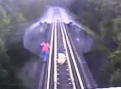 The pair had appeared top be doomed while crossing a rail bridge