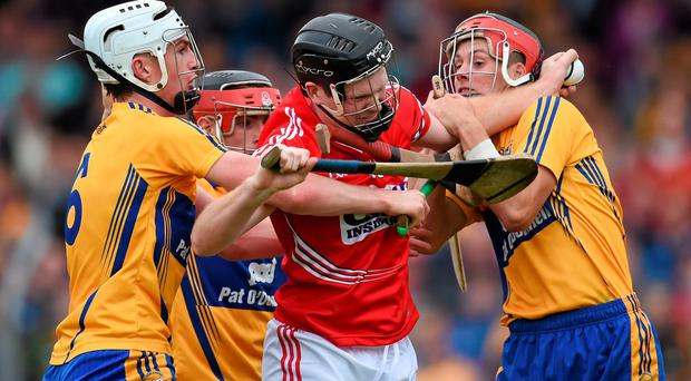 Cork's Shane O'Keeffe is halted by Clare pair Conor Cleary (left) and Jack Browne during the Munster U-21 HC final in Ennis. Photo: Stephen McCarthy / SPORTSFILE