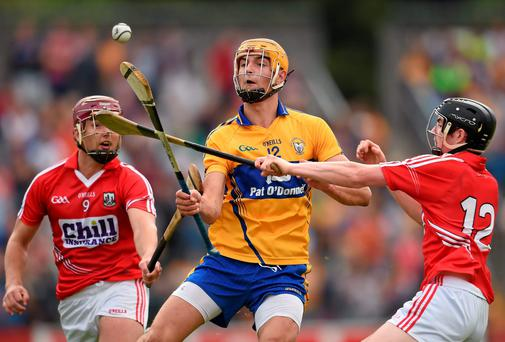 30 July 2014; Peter Duggan, Clare, in action against Rickard Cahalane, left, and Michael Collins, right, Cork. Bord Gais Energy Munster GAA Hurling Under 21 Championship Final, Cork v Clare. Cusack Park, Ennis, Co. Clare. Picture credit: Stephen McCarthy / SPORTSFILE