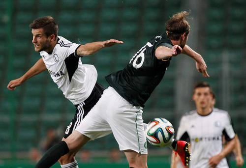 Celtic's Inge Jo Berget, right, and Legia's Tomasz Brzyski challenge for the ball during the Champions League first leg third qualifying round soccer match in the Pepsi Arena in Warsaw, Poland, Wednesday July 30, 2014. (AP Photo/Czarek Sokolowski)