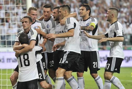 Legia's Miroslav Radovic is congratulated by teammates after scoring against Celtic in the Champions League qualifier at the Pepsi Arena in Warsaw. Photo: Piotr Hawalej/Getty Images