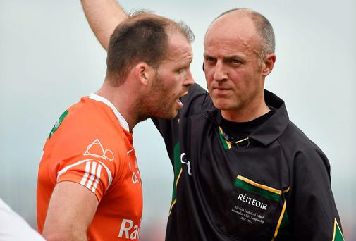 Referee Cormac Reilly has a word in the ear of Armagh's Ciarán McKeever after showing him a black card in the qualifier clash against Tyrone. Photo: Barry Cregg / SPORTSFILE