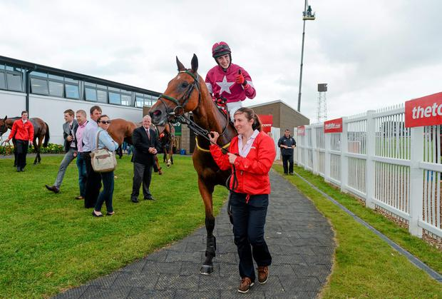 Jockey Shane Shortall celebrates on Road To Riches as he is led into the winner's enclosure by Riona Taggart after winning thetote.com Galway Plate. Photo: Barry Cregg / SPORTSFILE