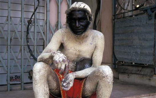 Hindu worshipper in a God Lord Hanuman costume Photo: Alamy
