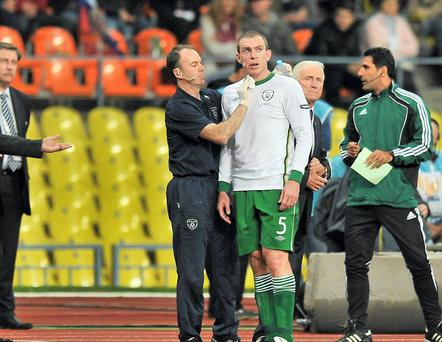 6 September 2011; Richard Dunne, Republic of Ireland, is attended to by team physio Ciaran Murray during the game. EURO 2012 Championship Qualifier, Russia v Republic of Ireland, Luzhniki Stadium, Moscow, Russia. Picture credit: David Maher / SPORTSFILE