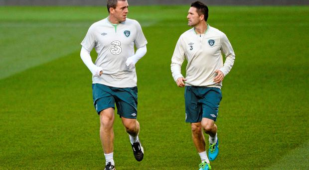 Republic of Ireland Squad Training - Monday 14th October...14 October 2013; Republic of Ireland's Richard Dunne, left, and Robbie Keane during squad training ahead of their 2014 FIFA World Cup Qualifier, Group C, game against Kazakhstan