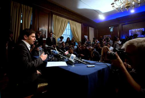 Argentina's Economy Minister Axel Kicillof speaks to the media at a press conference at the Argentine Consulate in New York July 30, 2014. Kicillof on Wednesday said the country offered a group of holdout creditors the same reduced payment terms it has agreed to pay other holders of its restructured bonds, but the holdouts refused the offer. The holdouts, a group of hedge funds that bought the bonds at a steep discount following Argentina's default on $100 billion of debt in 2002, also refused to ask a U.S. court to stay an order the blocks Argentina from paying its other creditors, Kicillof said. REUTERS/Carlo Allegri (UNITED STATES - Tags: BUSINESS POLITICS)
