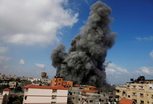 Smoke rises after an Israeli strike hit the offices of the Hamas movement's Al-Aqsa satellite TV station, in Gaza City, northern Gaza Strip. AP