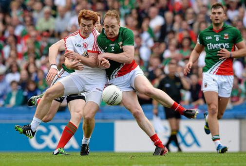 Peter Harte, Tyrone, and Tom Cunniffe, Mayo, clash shoulder to shoulder in the early stages of last year's All-Ireland Senior Championship Semi-Final between Mayo and Tyrone. Harte subsequently left the field following this incident. Picture credit: Ray McManus / SPORTSFILE