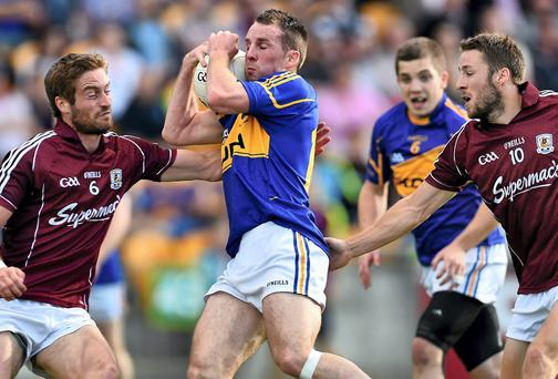 Galway's Gary O'Donnell, left, and Michael Lundy get tight on Tipperary's Peter Acheson in their qualifier clash in Tullamore when Galway got a lot of players in defence who didn't seem to be doing a lot of work back there. Picture credit: Ramsey Cardy / SPORTSFILE