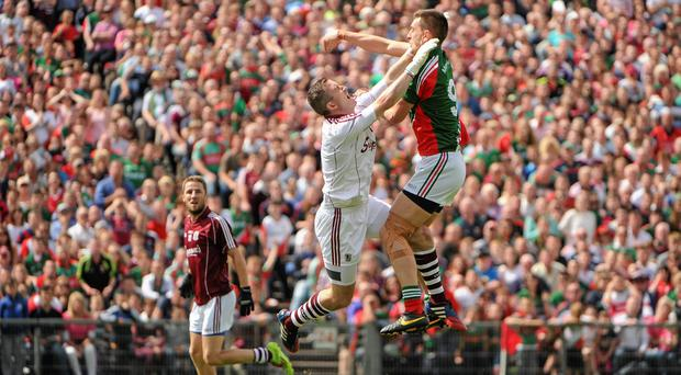 Mayo's Barry Moran (R) believes his team have learned to cope with being tipped as serious All-Ireland contenders each year. Tomás Greally / SPORTSFILE