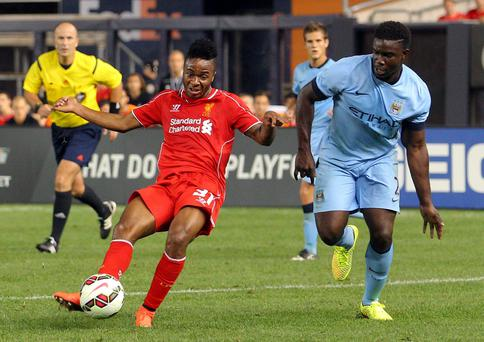 Liverpool's Raheem Sterling gets away from Manchester City's Micah Richards to score his side's second goal during their friendly game in New York. Photo Credit: Brad Penner-USA TODAY Sports
