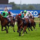 Heavy Metal (centre) ridden by Joe Fanning wins the Longines International stakes during the King George Day - Saturday at Ascot Racecourse. PRESS ASSOCIATION Photo. Picture date: Saturday July 26, 2014. See PA story RACING Ascot. Photo credit should read: Steve Parsons/PA Wire