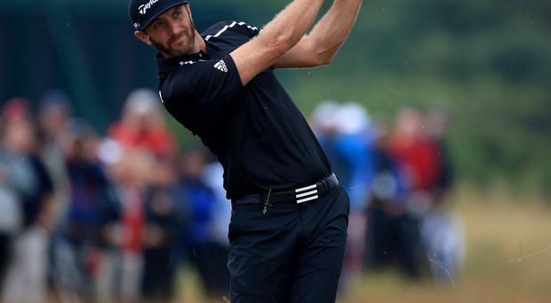 USA's Dustin Johnson reacts to a boogie on the 8th during day three of the 2014 Open Championship