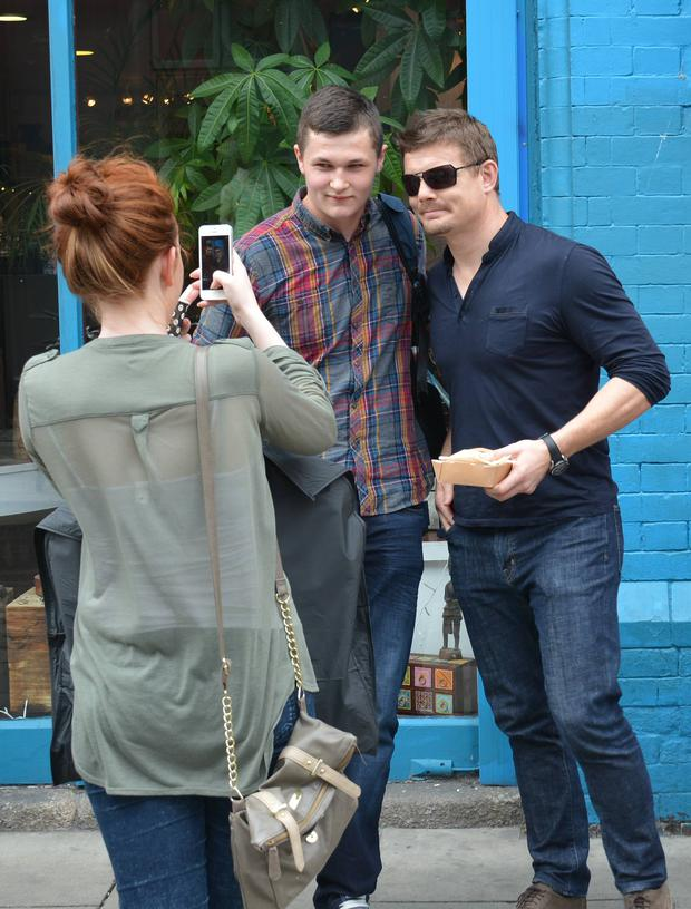 Newly retired rugby legend Brian O'Driscoll seen making a swift get-away with his lunch in his hand after posing with fans on Drury Street