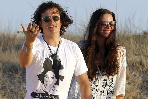 Orlando Bloom having a good time with Erica Packer and friends at restaurant in Formentera
