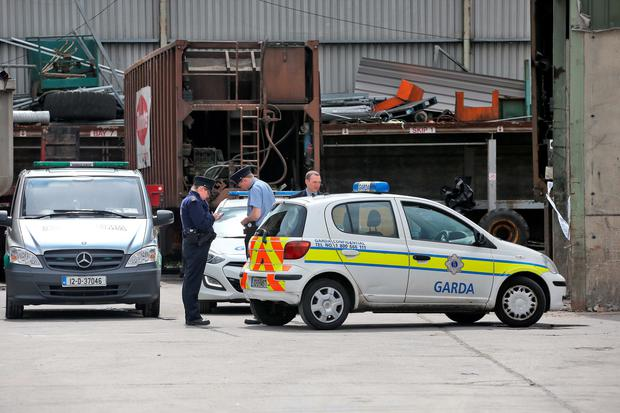 01/08/14 The body parts are removed from the scene at the Thorntons Recycling plant on Kileen Road, Ballyfermot, pictured this afternoon where a human leg was discovered in waste last night..the area has been sealed off while Gardai investigate... Picture Colin Keegan, Collins Dublin.