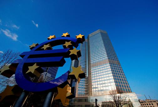 The stars of European Union (EU) membership sit on a euro sign sculpture outside the headquarters of the European Central Bank (ECB) in Frankfurt, Germany, on Wednesday, March 5, 2014. A month after saying he needs more data to make a decision, stronger-than-expected output and inflation and rising economic confidence might spare the European Central Bank president for now from radical steps such as negative rates. Photographer: Ralph Orlowski/Bloomberg