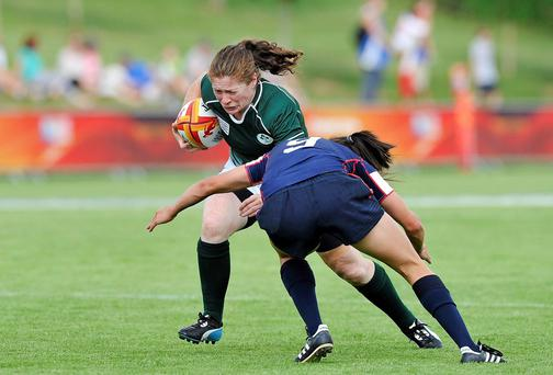 Ireland's Grace Davitt is tackled by Jocelyn Tseng of USA. Picture credit: Aurélien Meunier / SPORTSFILE
