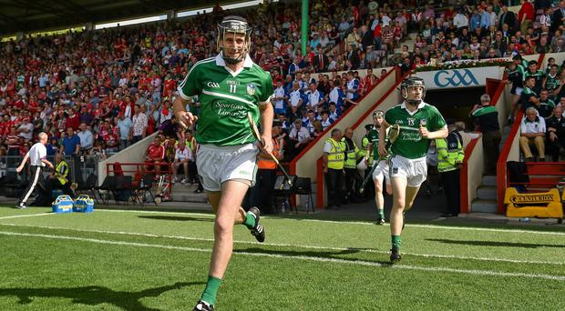 Limerick captain Donal O'Grady leads his team out