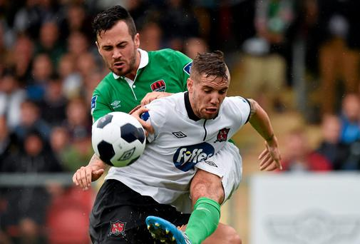Darren Meenan, Dundalk, in action against Ross Gaynor, Cork City