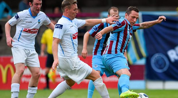 Gary O'Neill, Drogheda United, in action against Ian Ryan, UCD