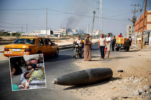 Palestinians observe an unexploded Israeli shell near Deir al-Balah in the Gaza Strip. Inset: Palestinian children, whom medics said were wounded by Israeli shelling, receive treatment at a hospital in Rafah in the southern Gaza Strip