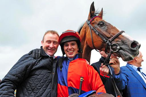Prince Rudi and jockey Ian McCarthy with trainer Stephen Nolan after winning the Ladbrokes Handicap Hurdle on day six of the Galway Festival at Galway