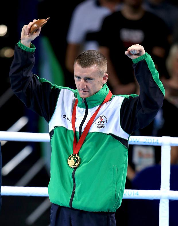 Ireland's Paddy Barnes with his gold medal on the podium