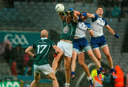2 August 2014; Tommy Moolick, Kildare, in action against Dessie Mone and Darren Hughes, Monaghan. GAA Football All-Ireland Senior Championship, Round 4B, Kildare v Monaghan, Croke Park, Dublin. Picture credit: Oliver McVeigh / SPORTSFILE