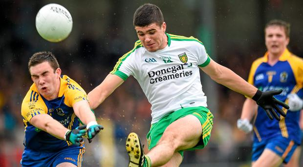 John Campbell, Donegal, in action against Evan McGrath, Roscommon