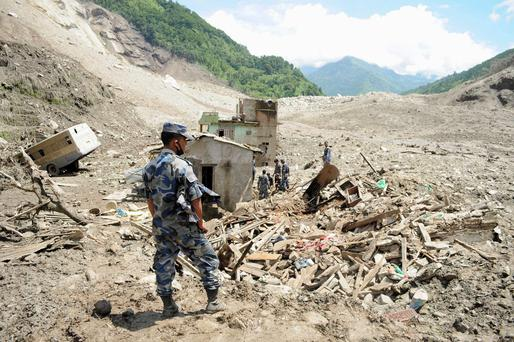 A massive landslide triggered by heavy rains in northeast Nepal on Saturday has killed at least eight people, injured 40 and buried dozens of homes
