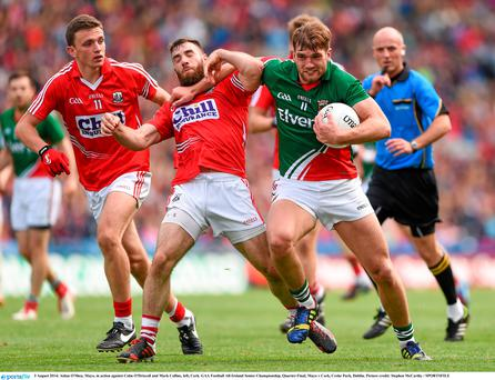 Mayo's Aidan O'Shea in action against Colm O'Driscoll and Mark Collins in the All-Ireland Quarter-Final
