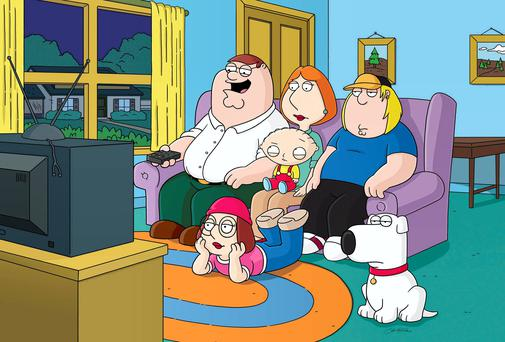 Family Guy - Peter, Lois, with Stewie on her lap, Meg, on ground, Chris and dog Brian