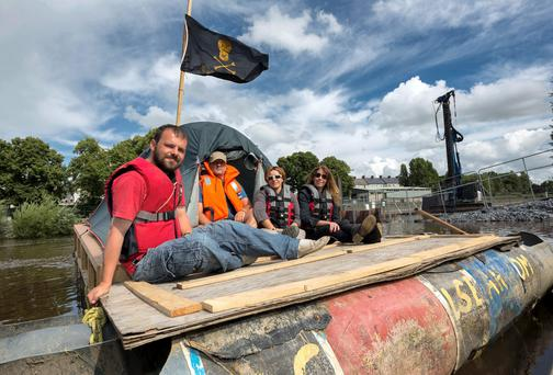 Anti CAS protesters on a homemade barge on the river Nore where the new bridge is being built, a pile driver working on the bridge is pictured in the background. Pictured from left is Jason Quinn, Mark Stewart, Anuska Gutierrez and Jean Brett. Picture: Dylan Vaughan.