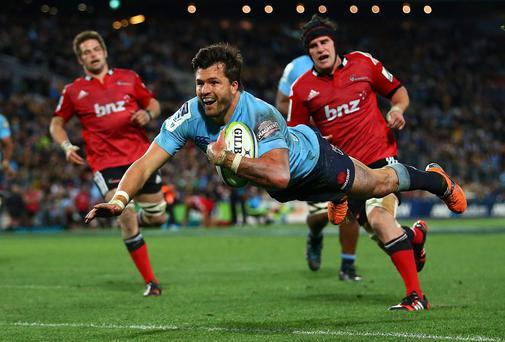 Adam Ashley-Cooper scores a try for Michael Cheika's New South Wales Waratahs as they won the Super Rugby final against the Crusaders in Sydney, Australia. Photo: Mark Nolan/Getty Images