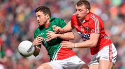Mayo's Chris Barrett and his Cork opponent Brian Hurley battle for possession during the All-Ireland qualifier at Croke Park. Photo: Brendan Moran / SPORTSFILE